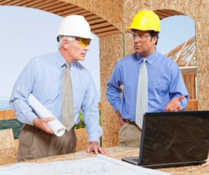 Two construction managers reviewing plans